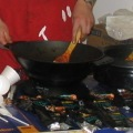 Food Tasting - Man cooking at wok
